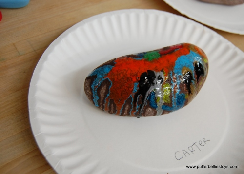 Crayon melted on a hot rock