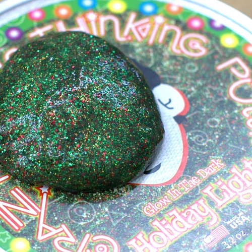 Holiday Lights Thinking Putty is packed with green, red and gold glitter. And it glows in the dark!